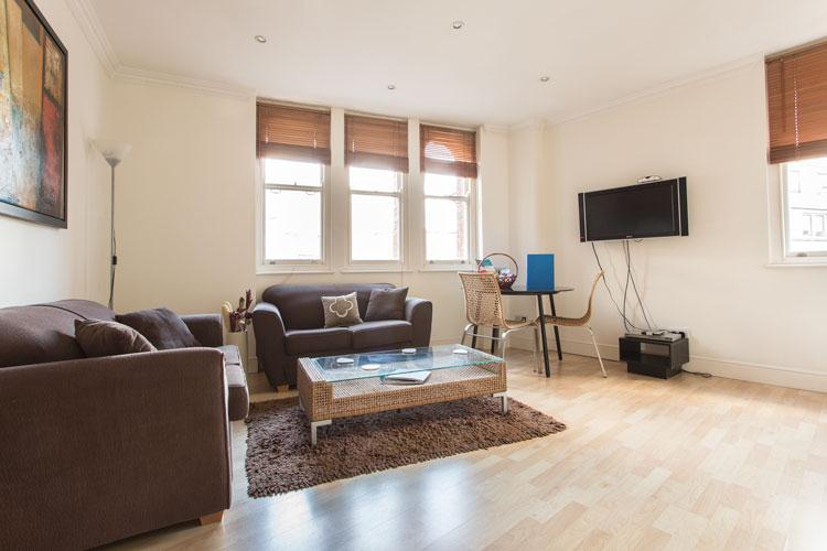 Astral House Serviced Apartments - Living Room