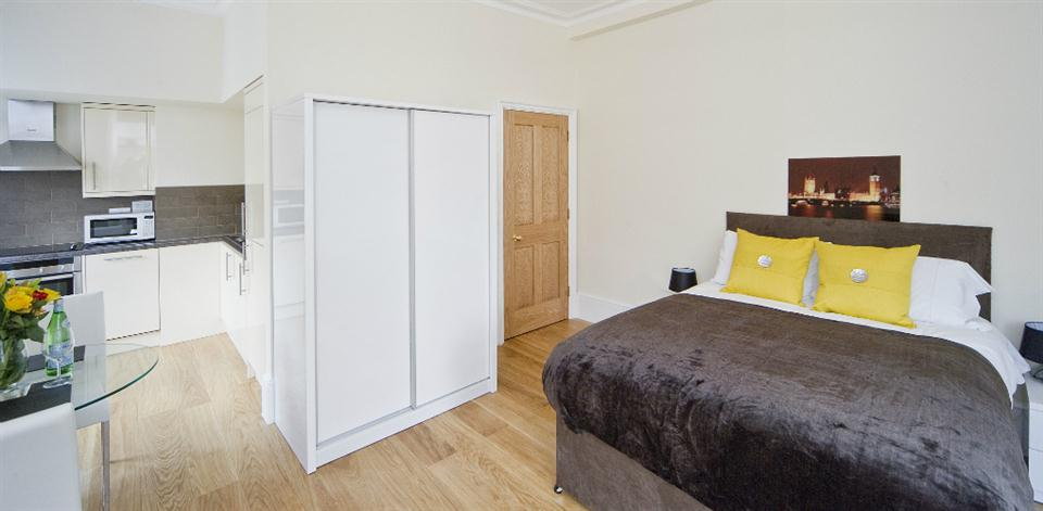 Leicester Square Apartments - Studio Living and Bedroom Area