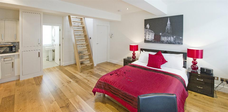 Trafalgar Square Apartments - Studio Bedroom Area